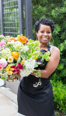 Goodshuffle Pro user, Sherronda Scoggins of floral company KC Events & Florals with a bouquet