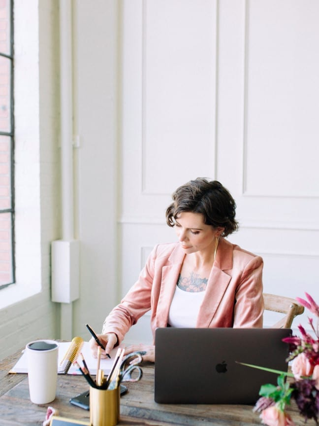 Lane' Richards, an event business consultant who helps market event businesses, at her desk