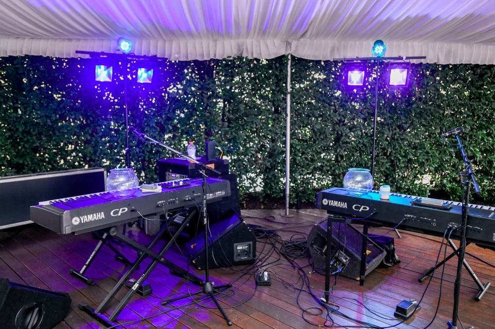 DJ and A/V equipment set up at an event.