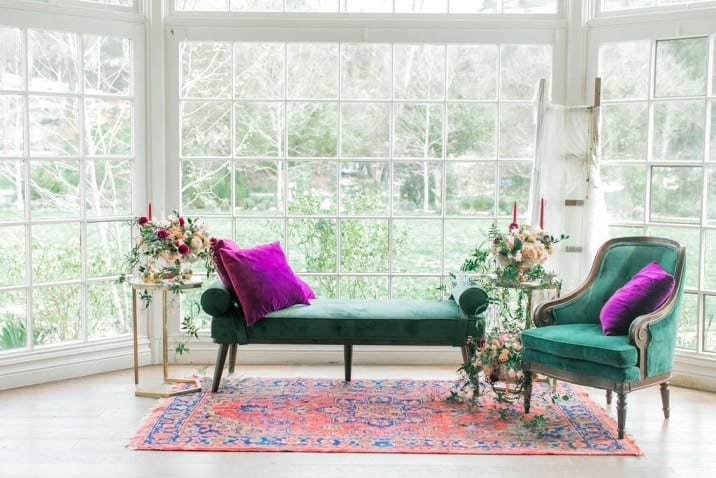 What's More Important: One-Time Customer or Venue Partnership? Beautiful vintage furniture in front of an open window for a wedding.