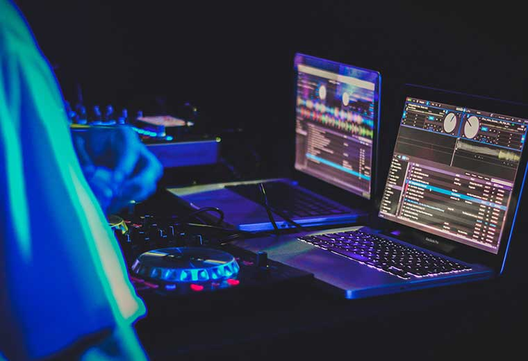 dj using computers at an event