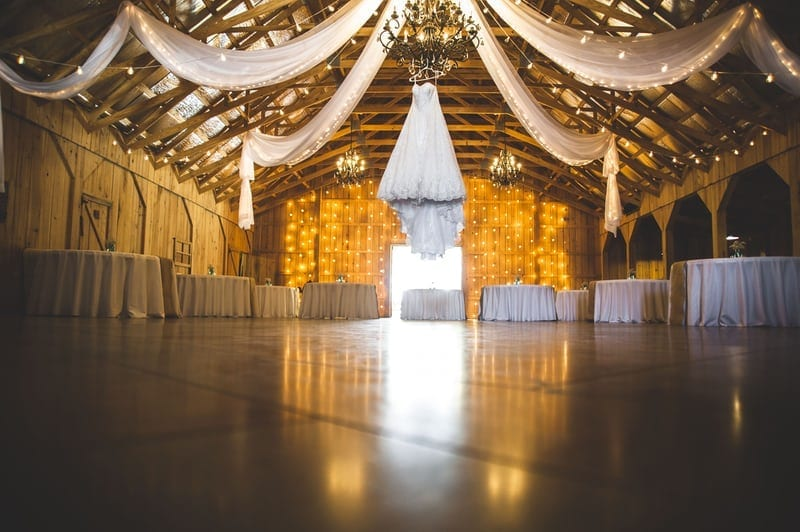 Wedding in barn with lighting and tables