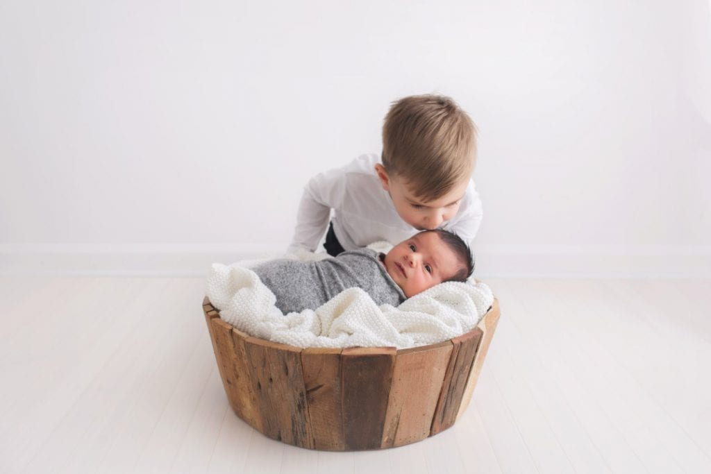 sibling photos with a newborn baby