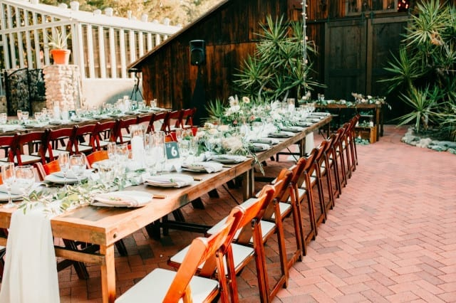 Farm Tables at an outdoor event. Photo by Nola Fontanez.