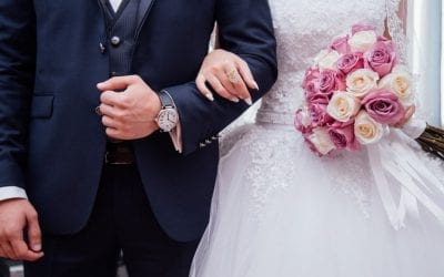 Bride and groom with wedding vendors