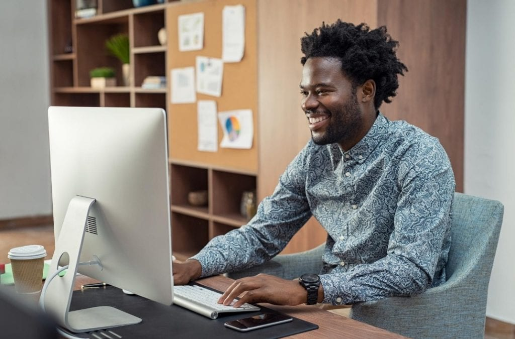 Man improving his event business website on the computer